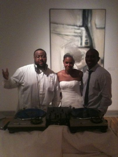 DJ Supa posing with the Bride and Groom after a great wedding Reception. This was take in...