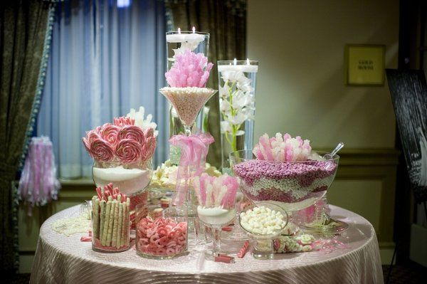 The high of these candy buffet makes it more beautiful because it makes it look like more candy.