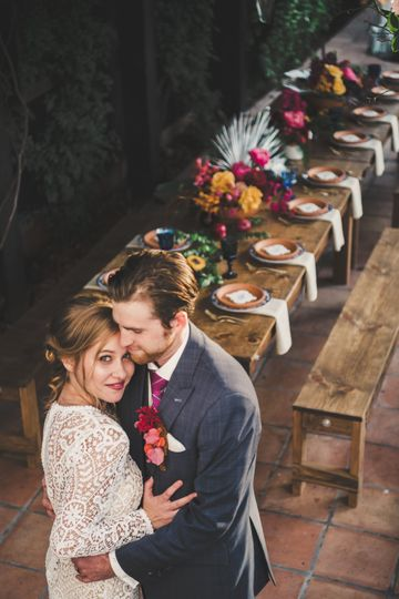 Newlyweds by the farm table