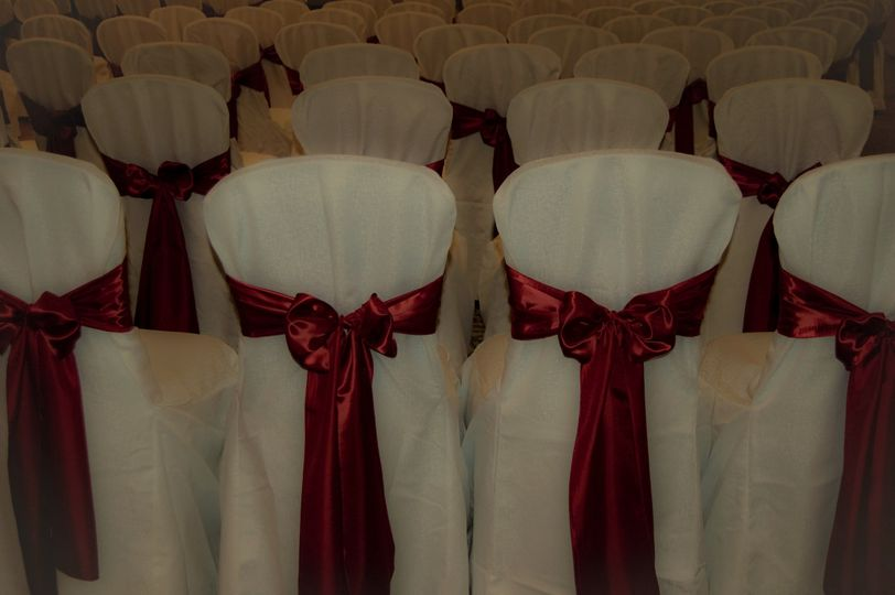 White chair cover with red ribbons