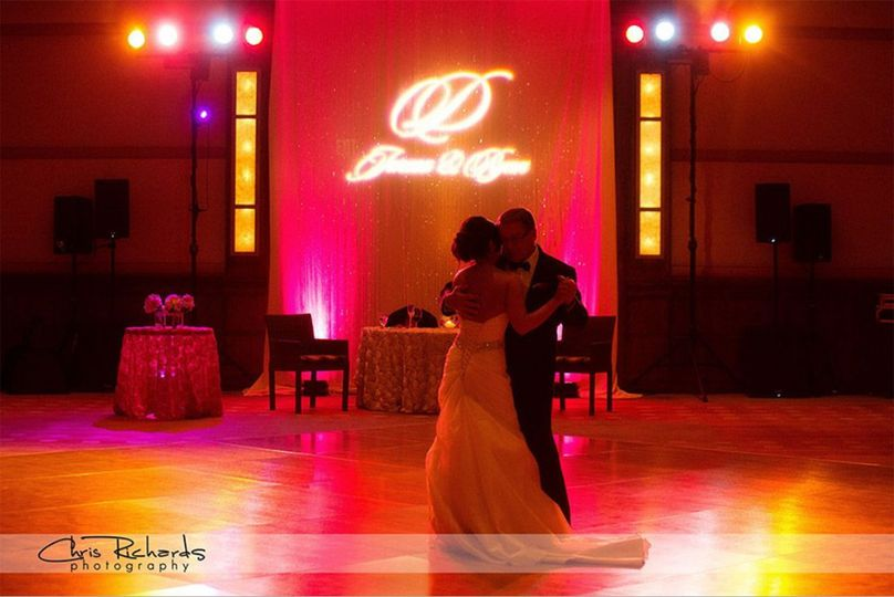 Our concert-level dance floor lighting, along with pink uplighting and a custom gobo, helped set the...