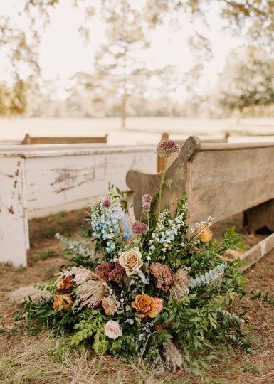 Aisle Flowers + Pews