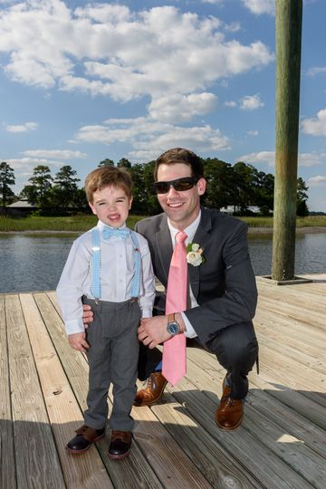 The groom with kid at the wedding