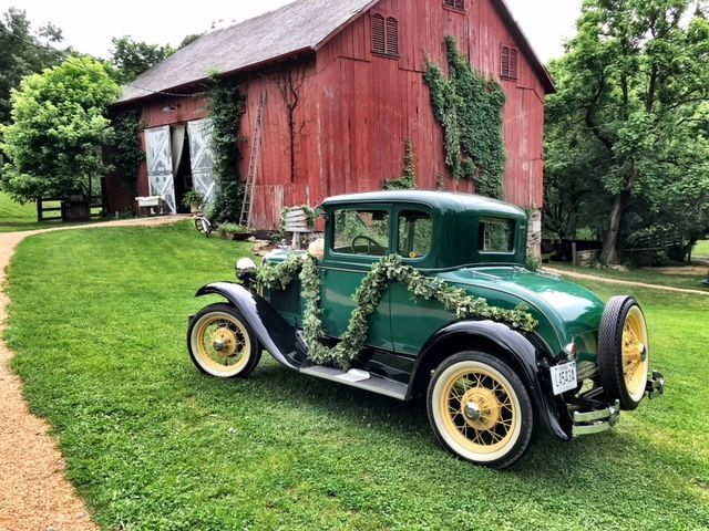 Vintage Car in front of barn