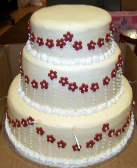 cake done in fbc with fondant flowers all the way around center of tiers and bridal charms in cake
