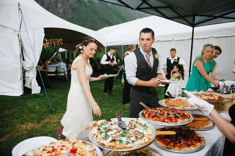 1c1cf61c1d93bd5e 1455829678764 bride and groom about to enjoy their pizza