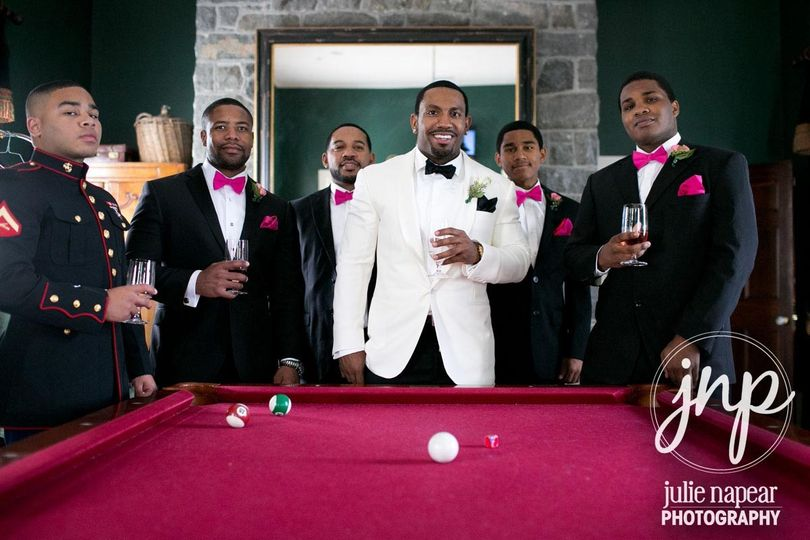 Groom and groomsmen at the pool table