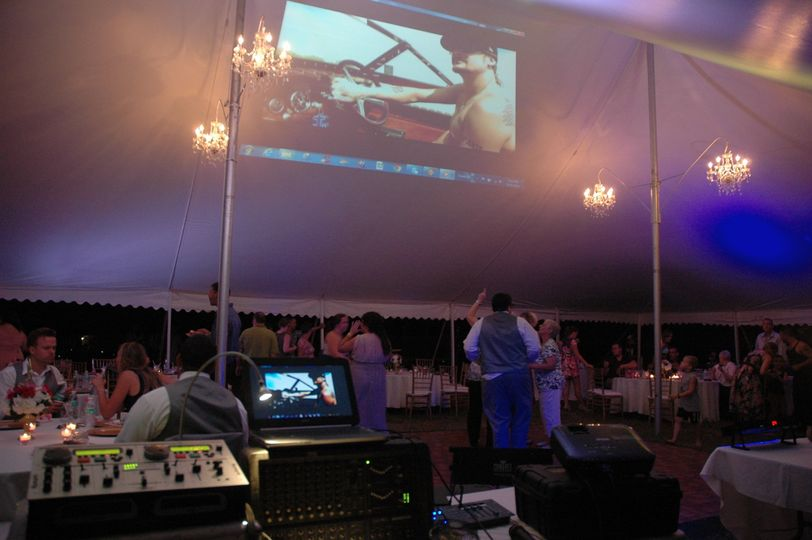Music videos projected on the roof of slanted tent. Customized Gobo Monograms also available.