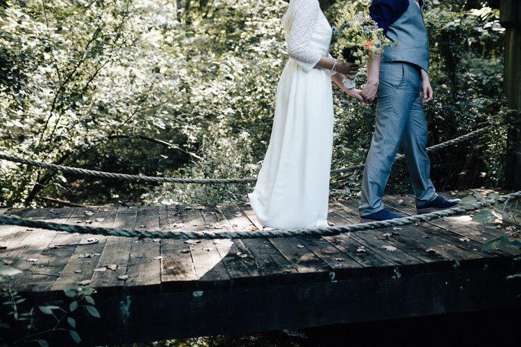 The bride and groom crossing the bridge
