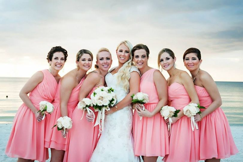 Bride and her bridesmaids at the beach