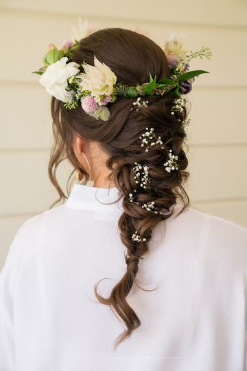 Braided wedding hair with accessory