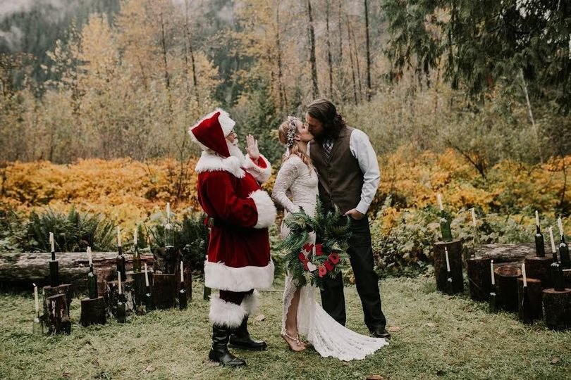 Couple kissing in front of Santa Clause