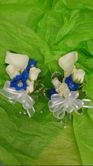 Pin on style corsages of white mini calla lily & spray roses with blue delphinium accents