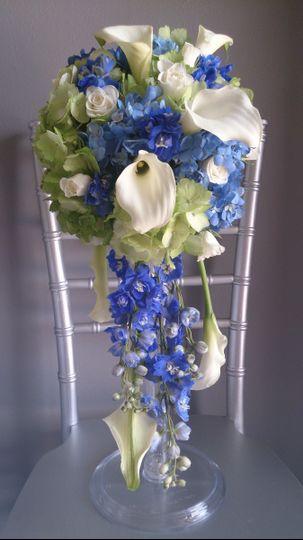 Cascading bouquet of hydrangea, calla lilies, delphinium & spray roses