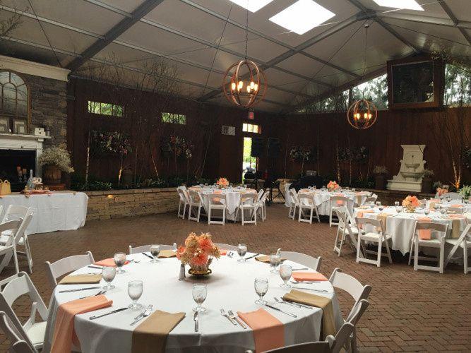 Reception tables with orange decor