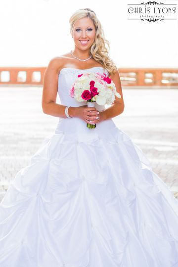 Beautiful bride under the dome at the Boston Harbor Hotel, getting ready to board the Odyssey for...