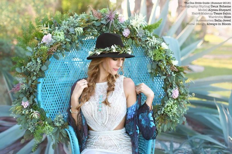 Flower crown around bride's hat