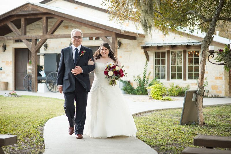 Bride escorted by her father