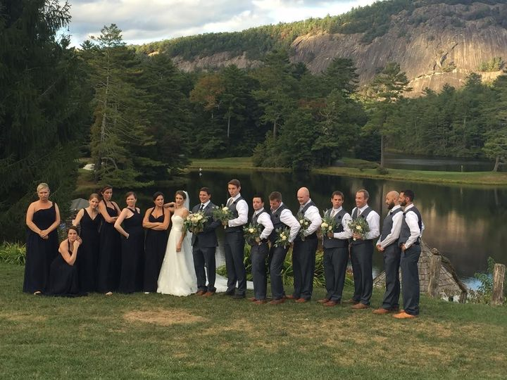 Newlyweds and their guests by the lake