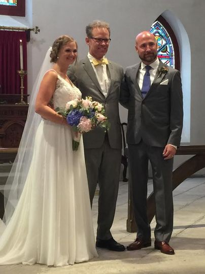 Wedding officiant and the newlyweds