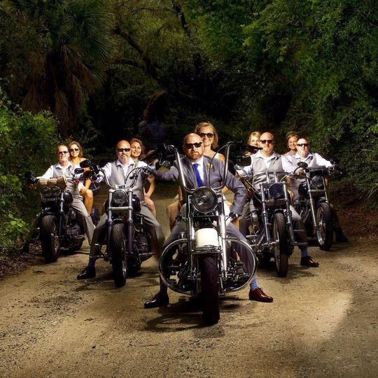 Newlyweds and their guests on motor bikes