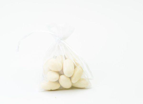 White Jordan almonds in a delicate organza bag are a classic favor for weddings.