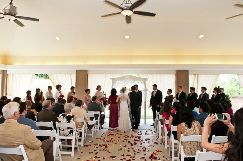 Being escorted by both parents down the rose petal lined aisle in front of family and friends on our...