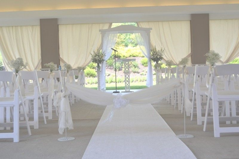 Ceremony set up with aisle runner and tellis on The Chadwick's patio