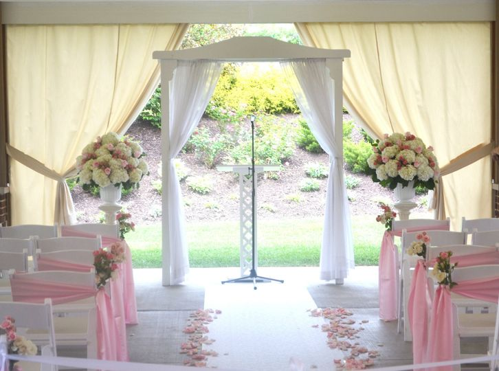 patio with chair sashes and florals