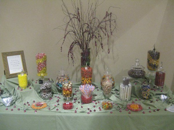 A candy buffet with various candies chosen by the bride in fall colors.