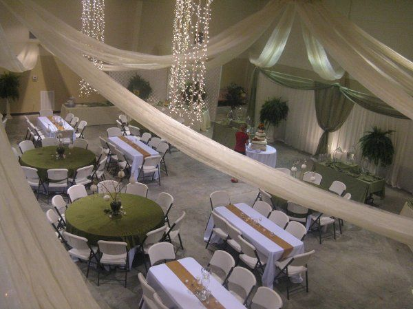 A ceiling treatment consisting of fabric hung from the ceiling with light columns.