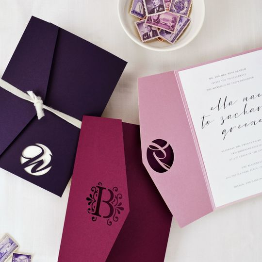 Laser cut monogram pockets to personalize your wedding invitations. Shown in Amethyst, Burgundy, and...