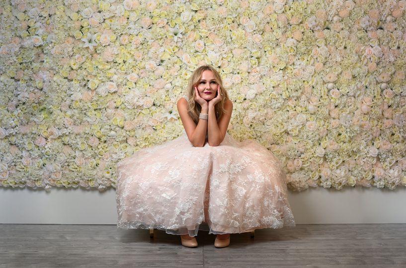 Posing in front of Lovely White flower wall