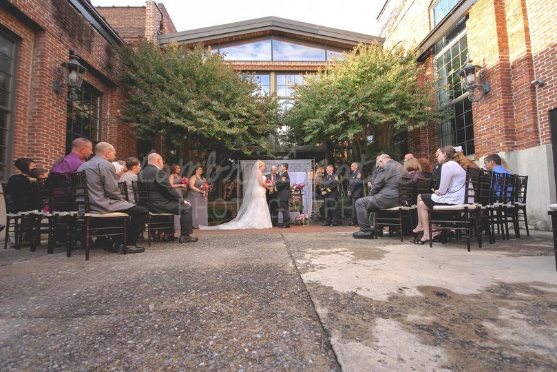 Courtyard Wedding Ceremony OctoberPhoto by: Cambria Creative