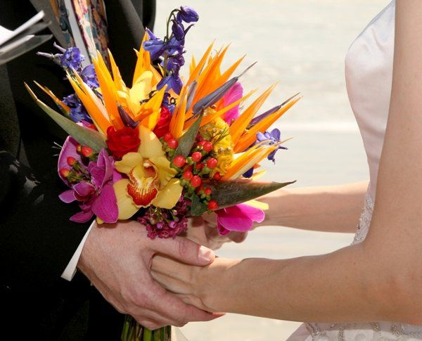 Hand-tied bouquet of Bird of Paradise, delphinium, orchids, celosia, photo by Aubrie's Photography