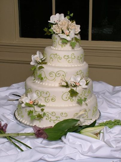 5-tier wedding cake with green detailing