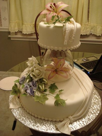Floral wedding cake with a hanging layer