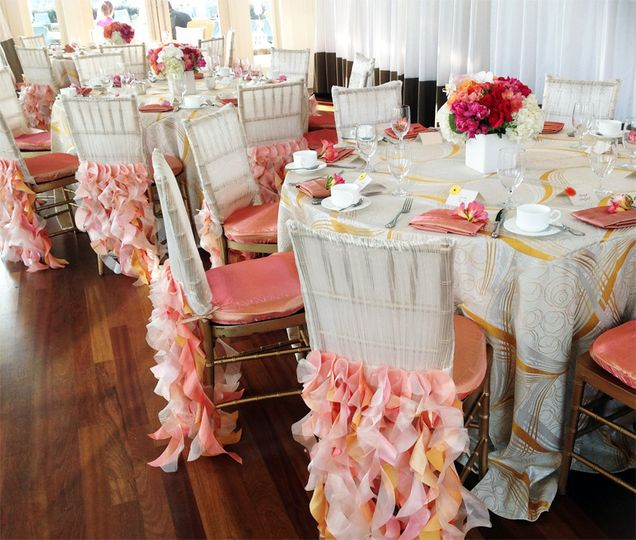 Sherbet inspired wedding brunch. Pinks, corals, oranges & white reception tables & centerpieces.