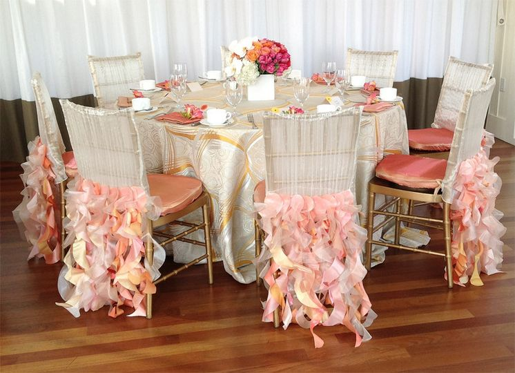 Sherbet inspired wedding brunch. Pinks, corals, oranges & white reception table centerpieces.