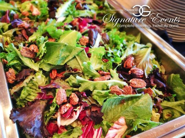 Field Greens Salad featuring Cranberries and house-made Praline Pecans with Blue Cheese Crumbles &...