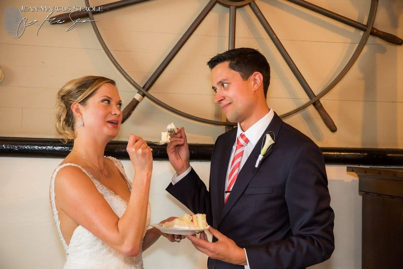 bride and groom cake eating