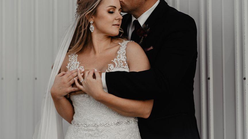 Groom Hugs his Bride