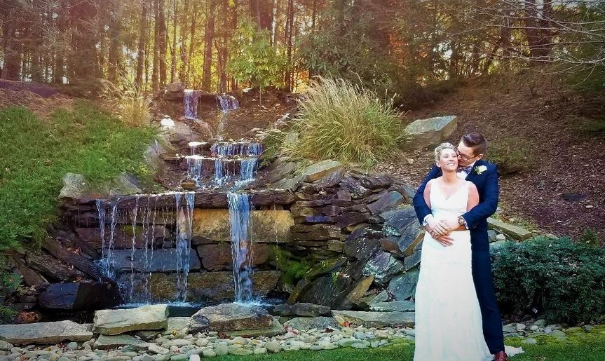 Wedding couple by waterfall