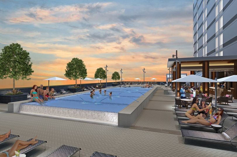 The outdoor pool features several cabanas as well as an outdoor pool bar.