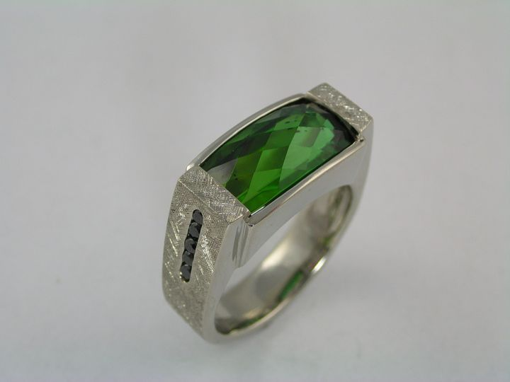 14 karat white gold gents wedding ring set with Stephen Avery diamond back cut green tourmaline with...