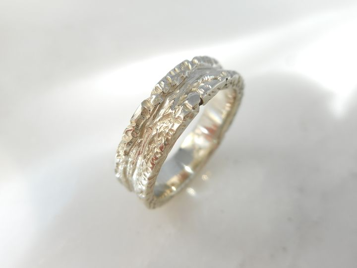"14 karat white gold ""wild river"" wedding band"