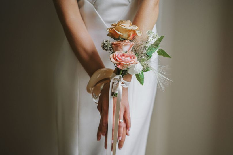 Flowers on the bride's wrists