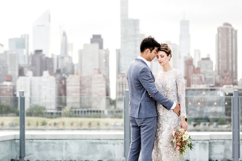 Newlyweds with the skyline in the backdrop