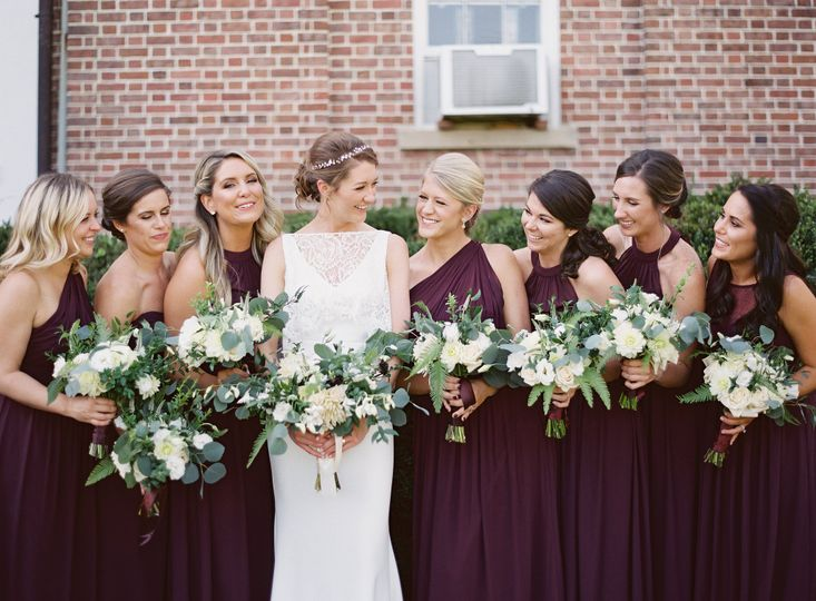 Bridesmaids wearing violet