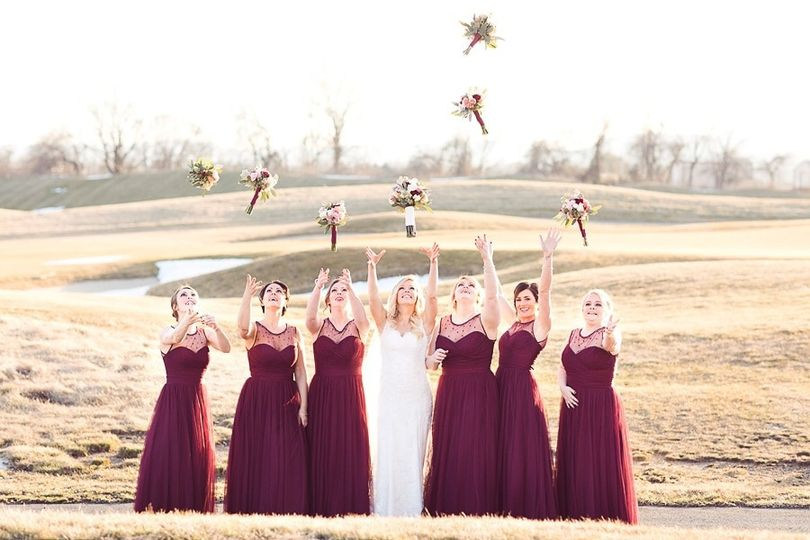 Bridal party throwing their bouquets